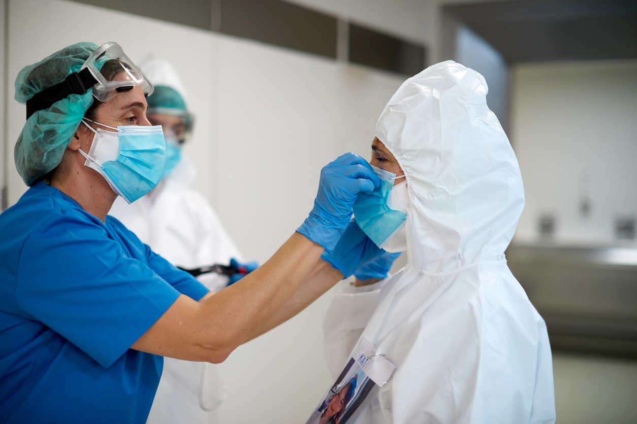 COVID-19 doctors wearing medical clothing, autoimmune disease research concept