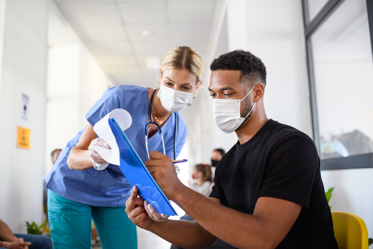 A nurse talking to a patient, clinical trial terminations concept