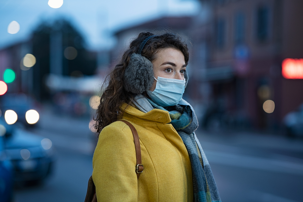 Young woman wearing a mask during flu season